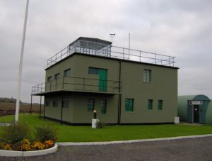Image of two story Control Tower, a part of today's Parham Air Field Museum.